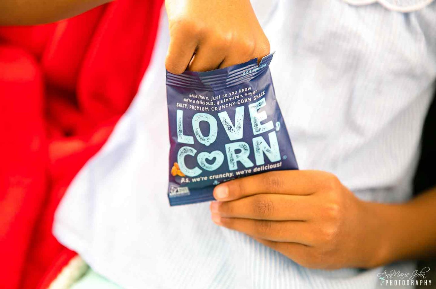 eating LOVE CORN snacks